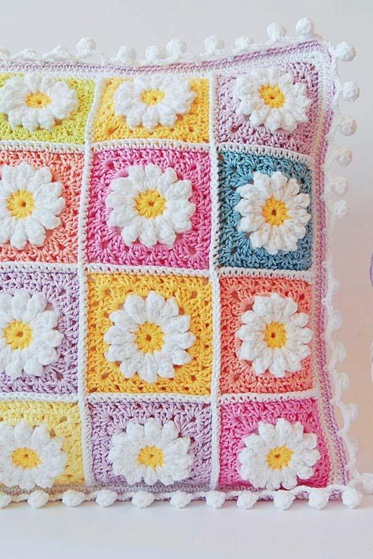 Crochet cushion cover with squares of daisies
