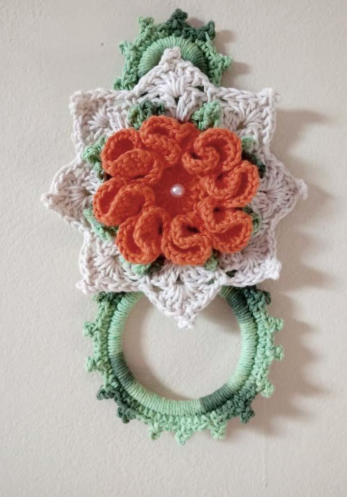 Crocheted crockery dish with flower and petal