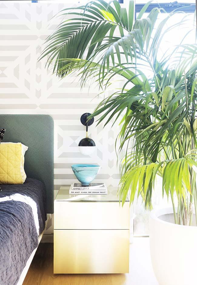 Freshness and rusticity with raffia palm next to the bed