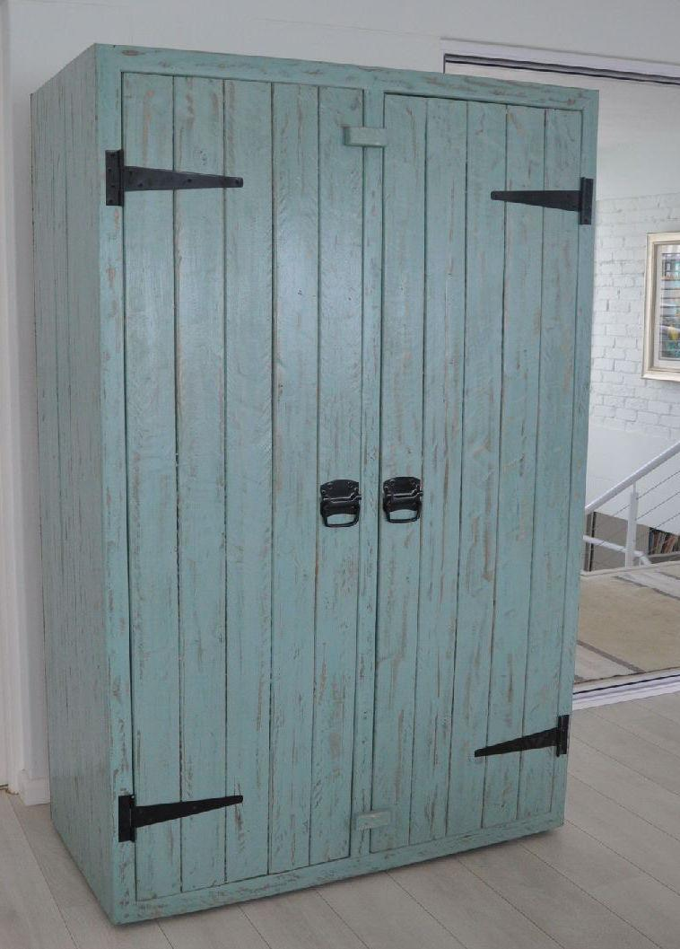 Pallet cabinet with blue patina finish door