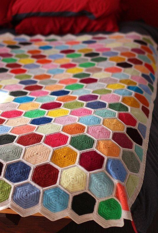 Colorful hexagons on the crochet quilt