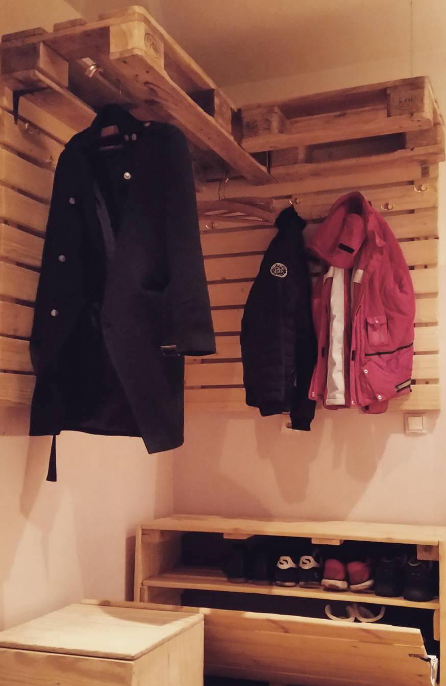 Wardrobe with wall covered with pallets