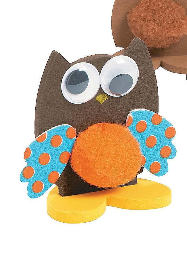EVA owl with wooden stand to stand