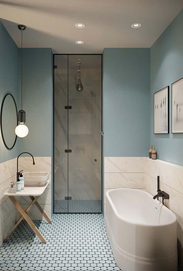 Bathroom with half pastel blue wall