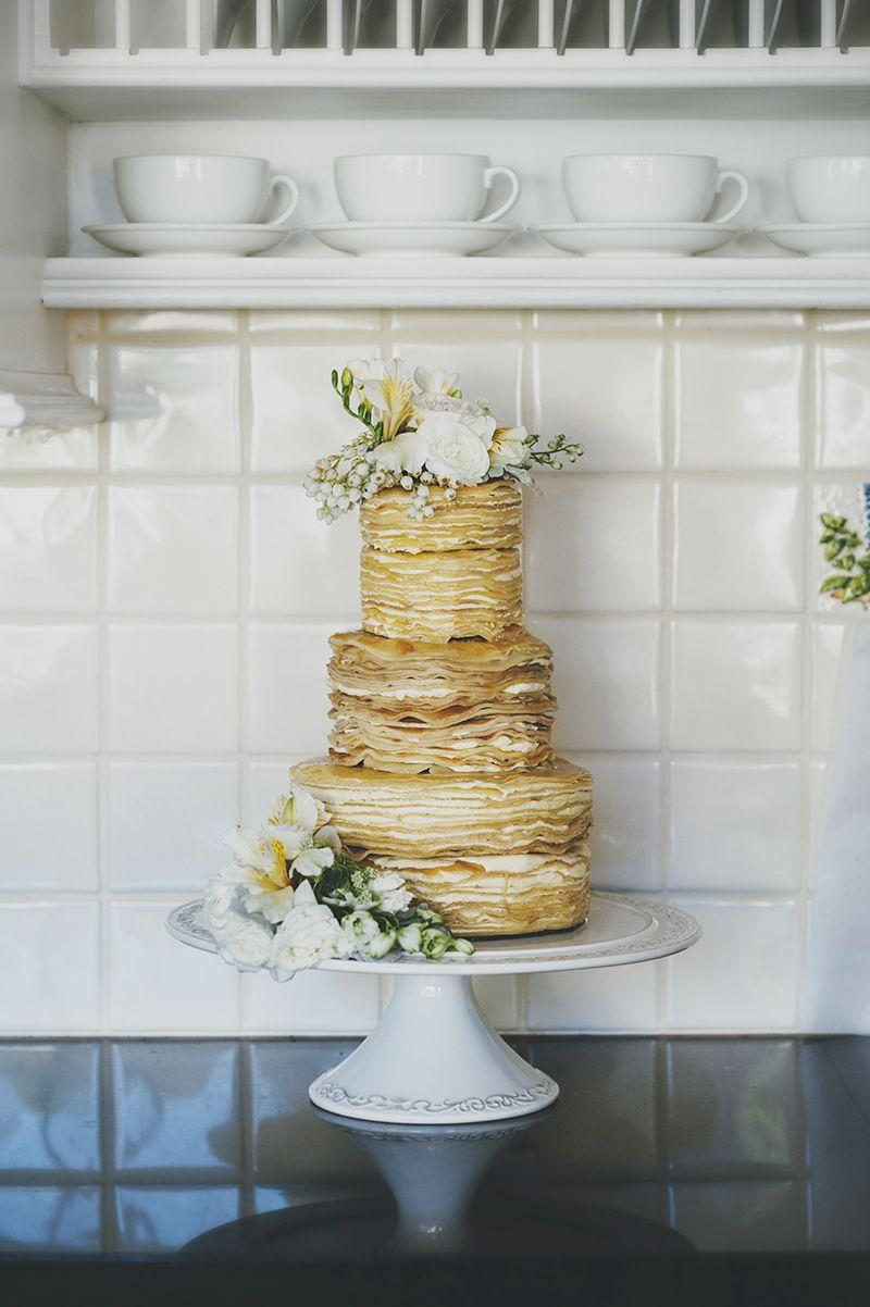 Naked simple cake decorated with white flowers