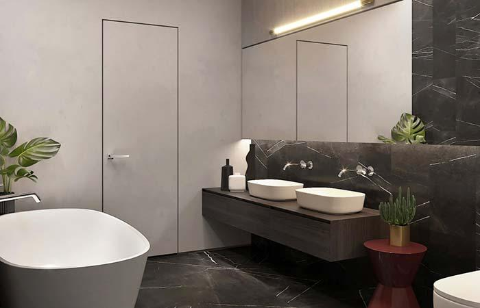 Floor and half wall with black granite