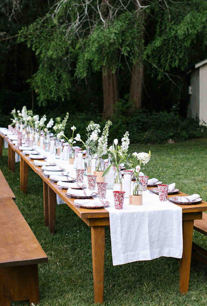 If the engagement party goes outdoors, sit on a single table to accommodate all the guests