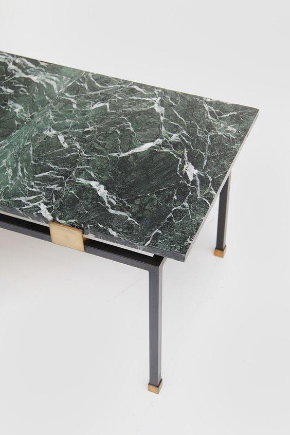Table with green marble top;  seagull to give movement to the stone