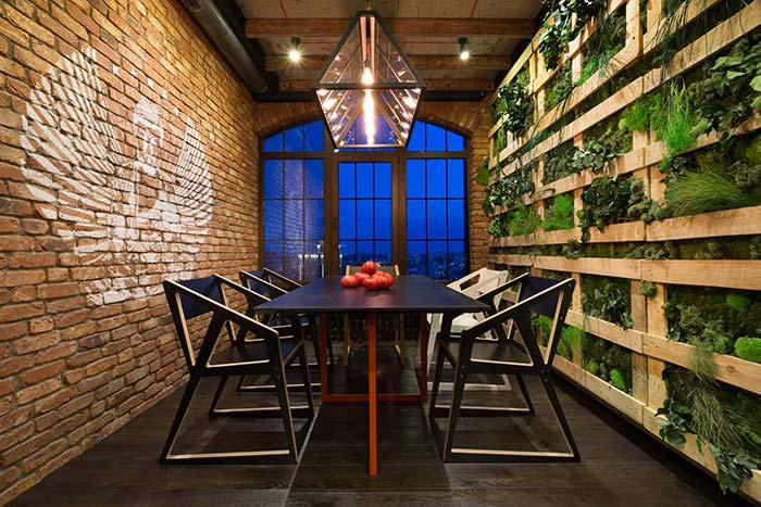 Brick wall and vertical garden of pallet