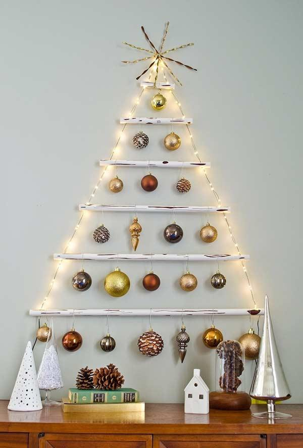Tree on the wall with metallic decoration