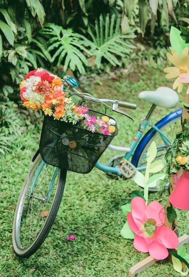Bicycle decorated with flowers in the basket