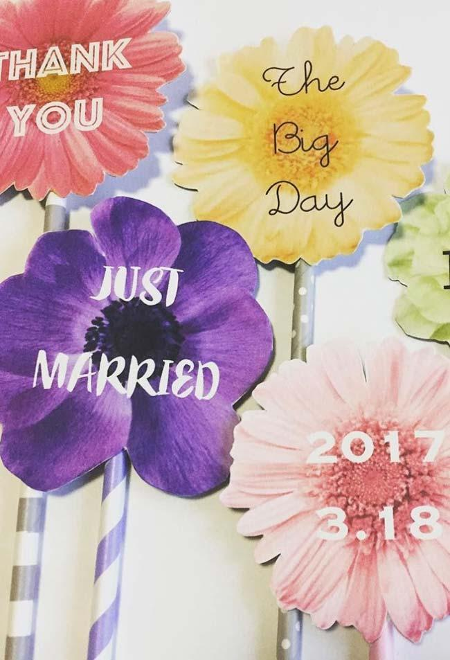 Assorted flowers make the background of these wedding party inserts
