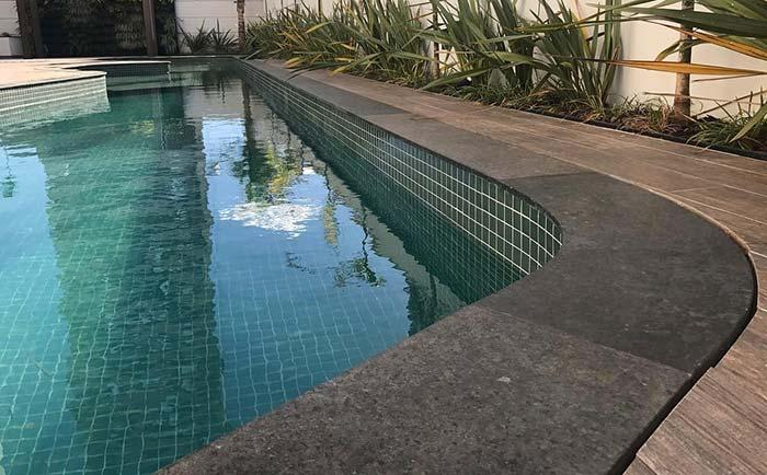 Ubatuba green granite on the edge of the pool