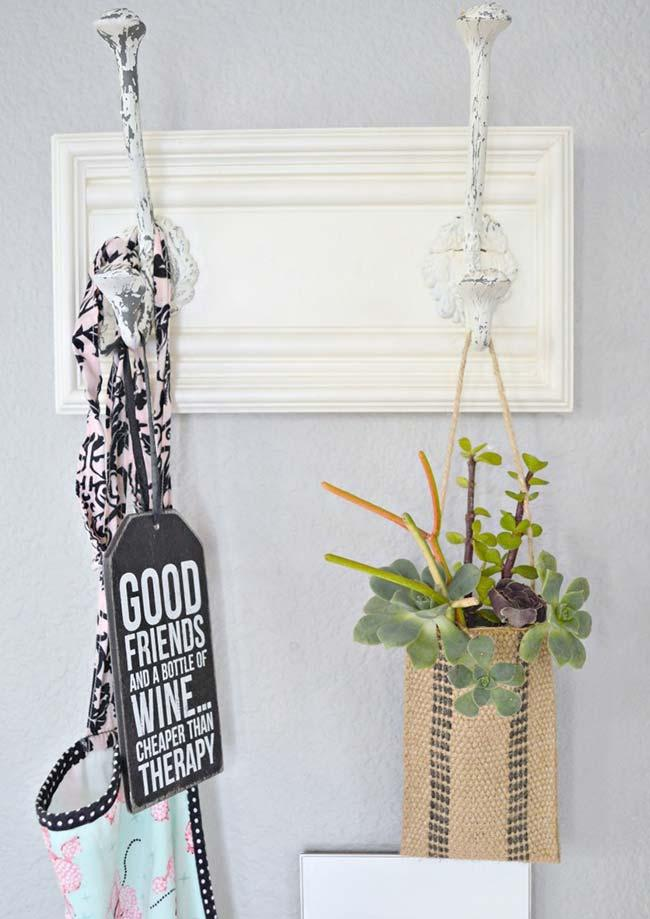 Succulents in the rack for entrance hall