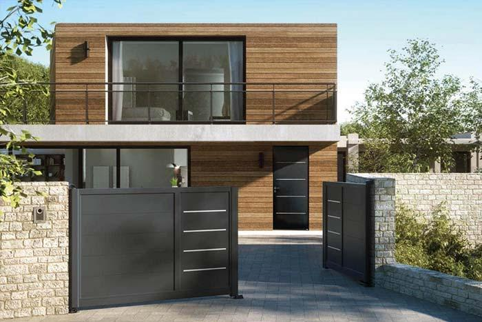 Wooden house with brown aluminum gate
