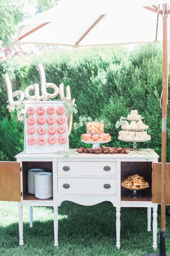 Baby prepared baby diner with a large candy table