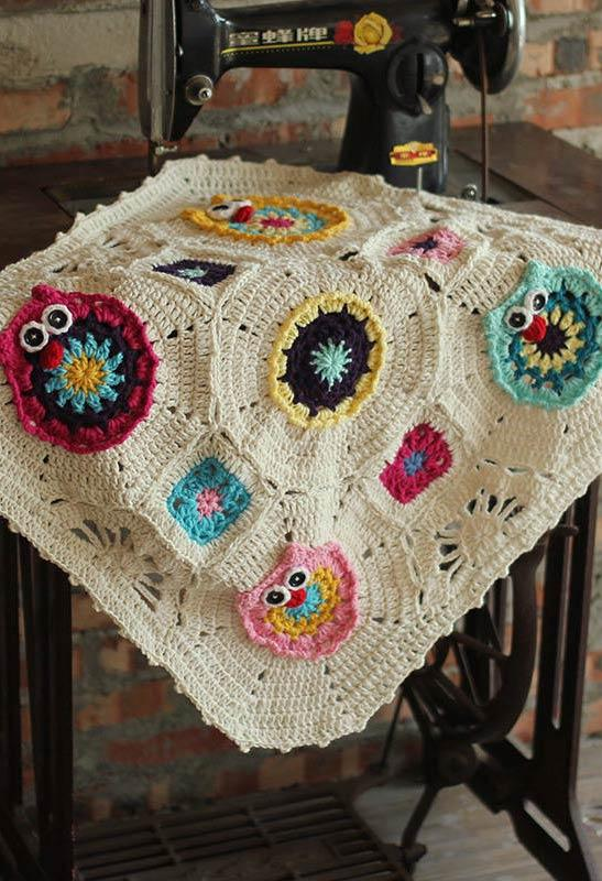 Neutral rug with applied crochet owls