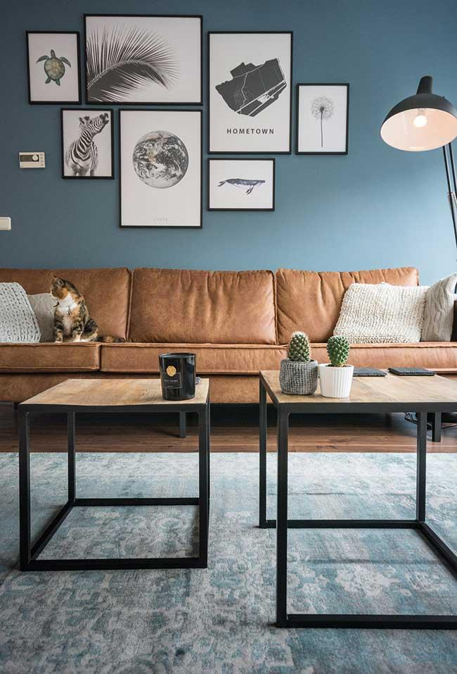 Blue wall and brown leather sofa