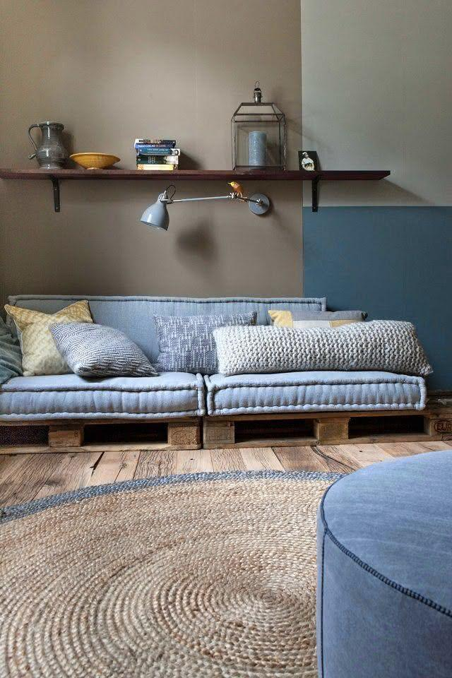 Pallet sofa with blue upholstery