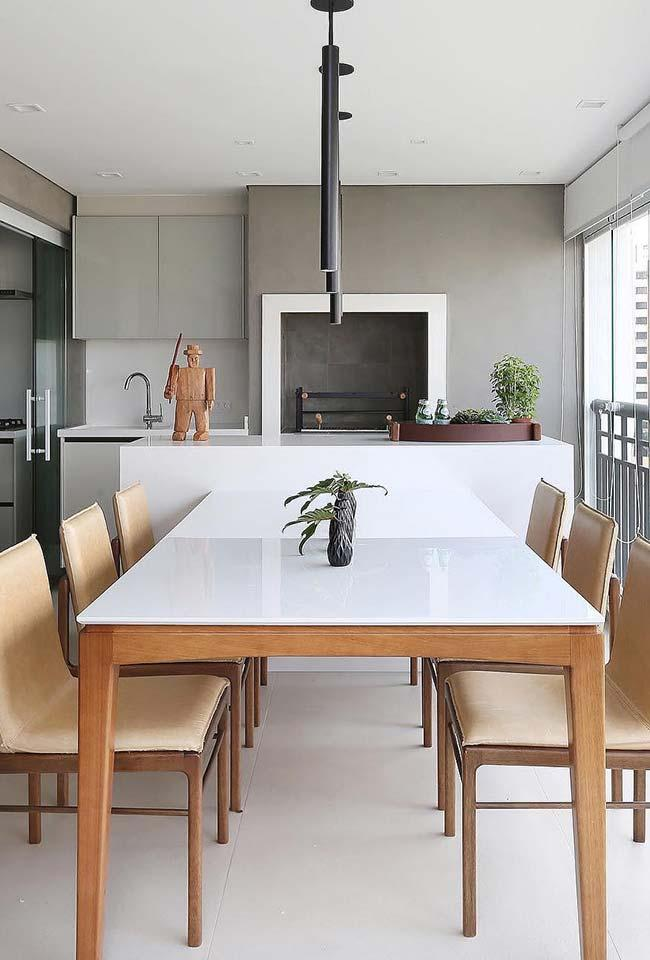 White lacquered table on the balcony with satin-finished porcelain floor