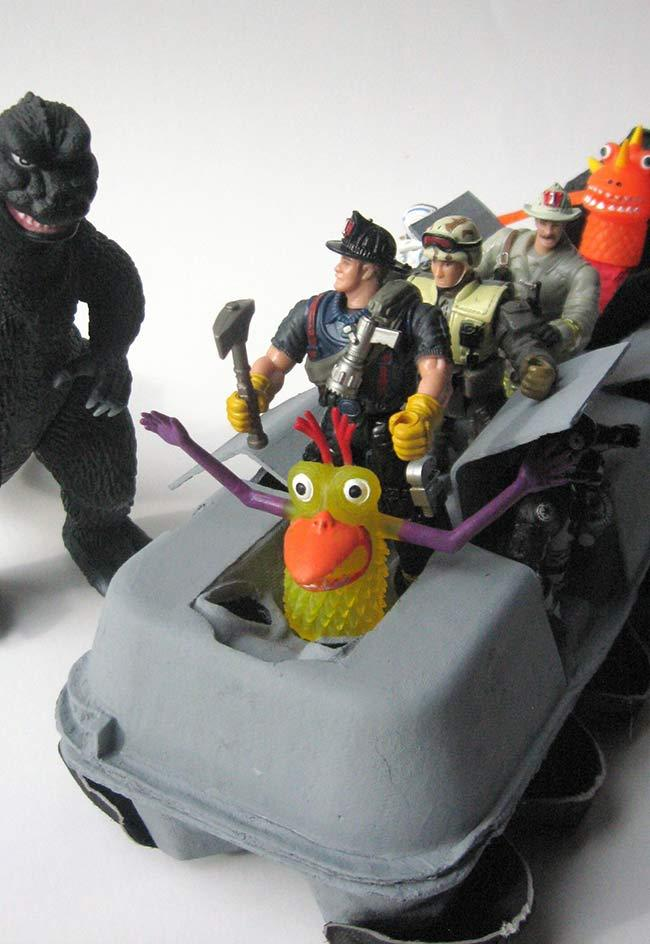 Toy vehicle for puppets in action