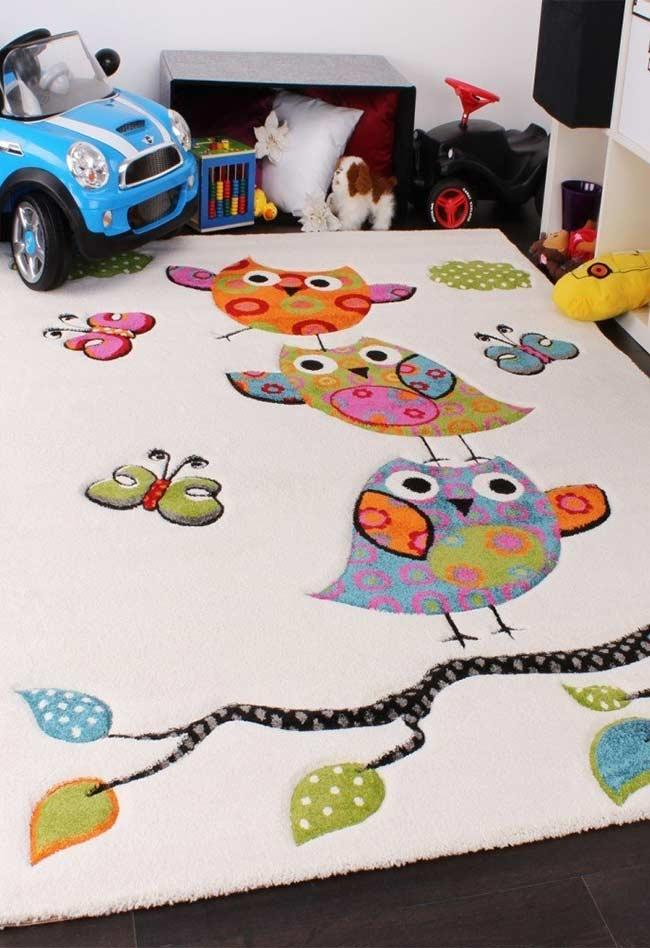 Super cheerful owls on the carpet
