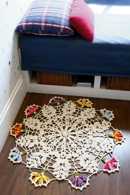 Round crochet rug with colorful flowers