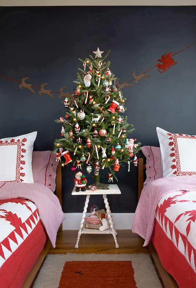 Santa Claus, reindeers, elves and candy in the decoration of the Christmas tree