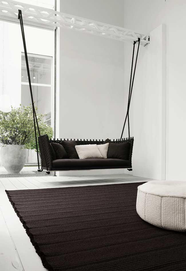 Black sofa Suspended by Strings
