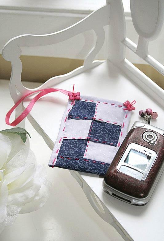 Delicate cell phone sleeve worked in patchwork