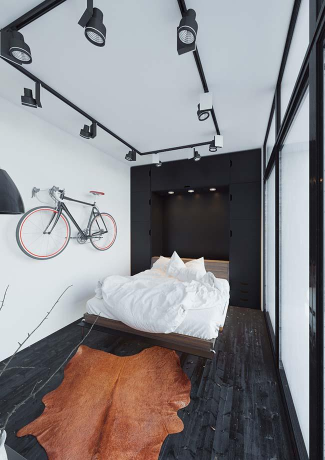 The white burnt cement wall was decorated with a bicycle