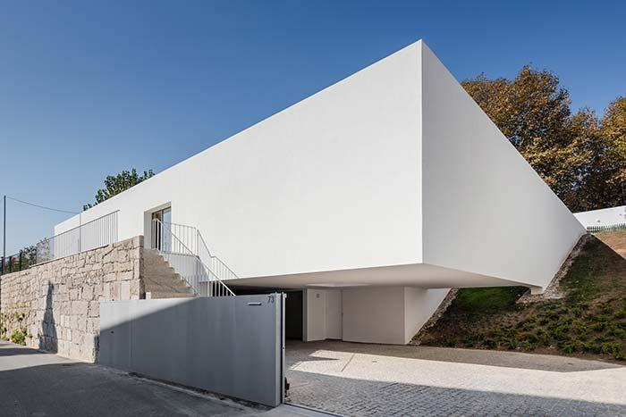 Stone wall and white aluminum gate