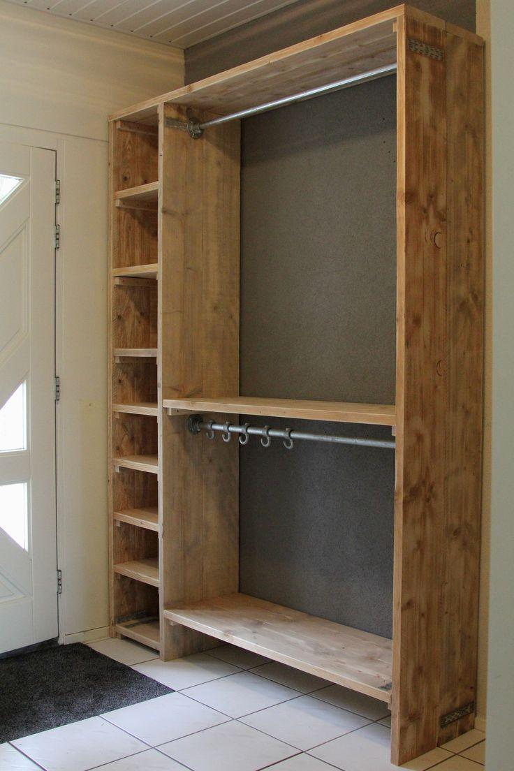 Open pallet wardrobe with shelves and macaws.