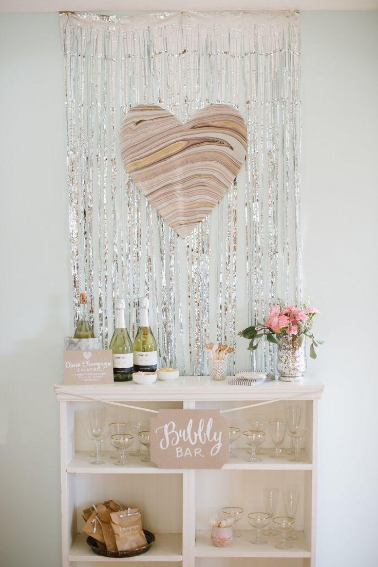 A simple bar for the guests to decorate with metal tape and paper heart