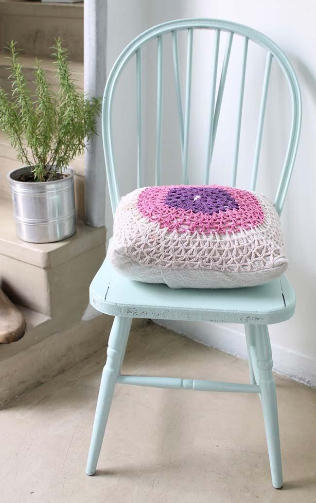 Crochet cushion cover made with wide open stitches