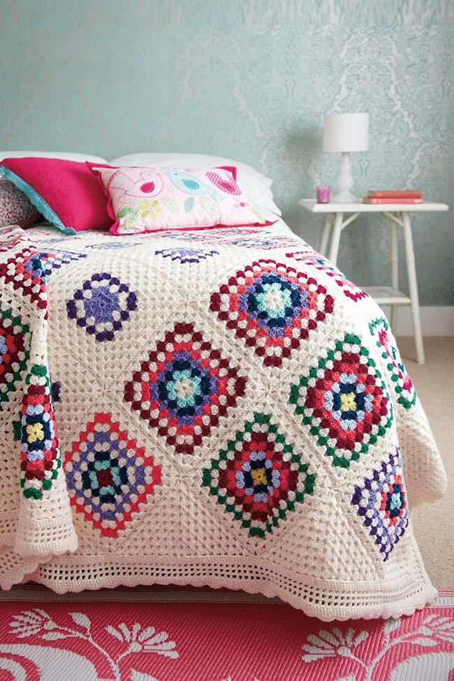 Crochet quilt with colorful lozenges