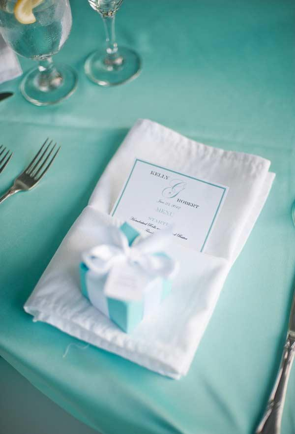 Table with white napkin, towel and blue gift box Tiffany