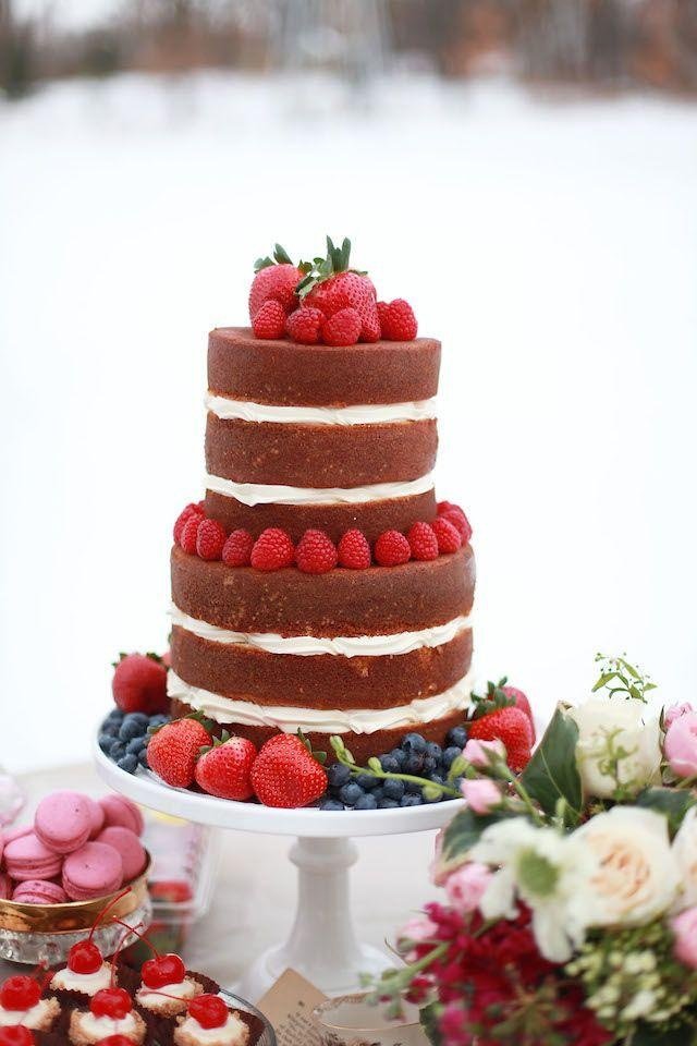 Simple wedding cake with strawberry and blueberries