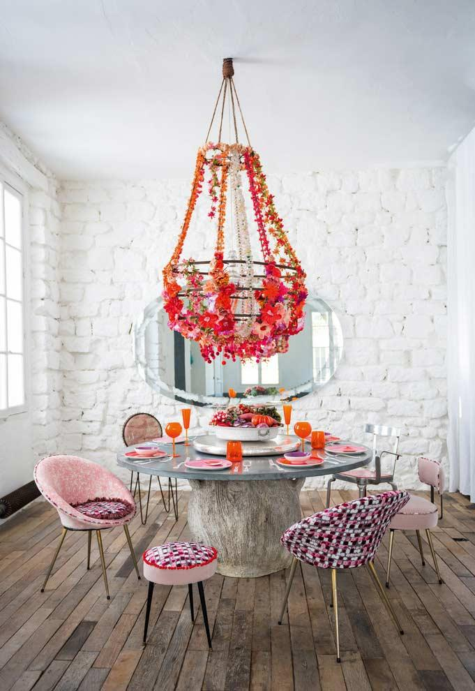 Composition with artificial flowers on the chandelier