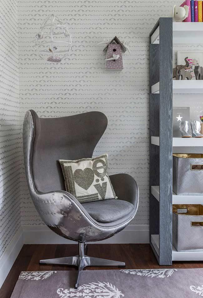 Egg swivel armchair with silver accents