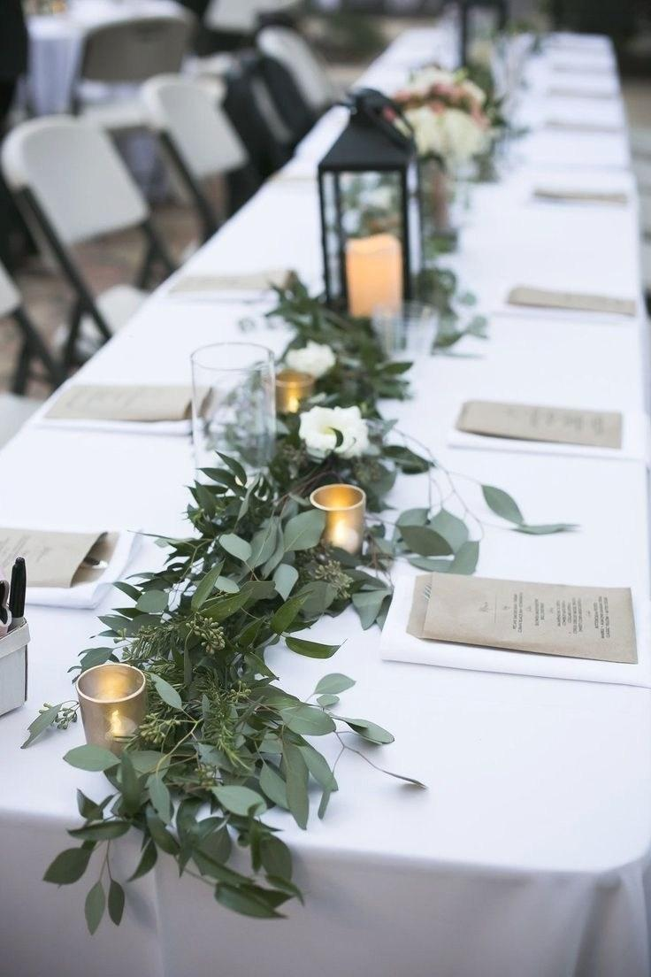 Unique table decorated with arrangement of leaves in cheap wedding