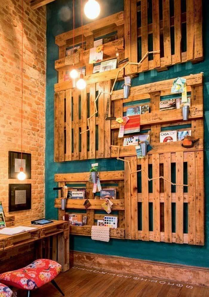 Design with wall of pallets shelves and supports for magazines