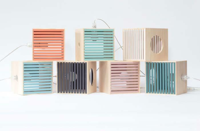 colorful wooden crates with lamps inside