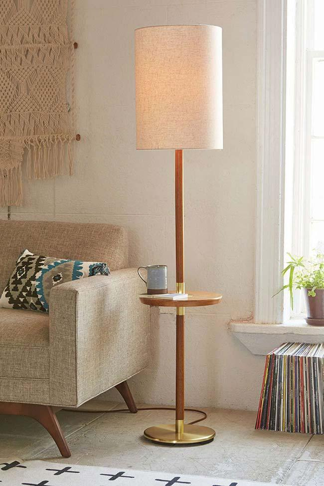 Wooden floor lamp used as a support table