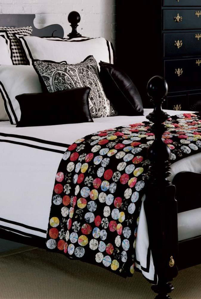 Fuxico bedspread brings color to the neutral room