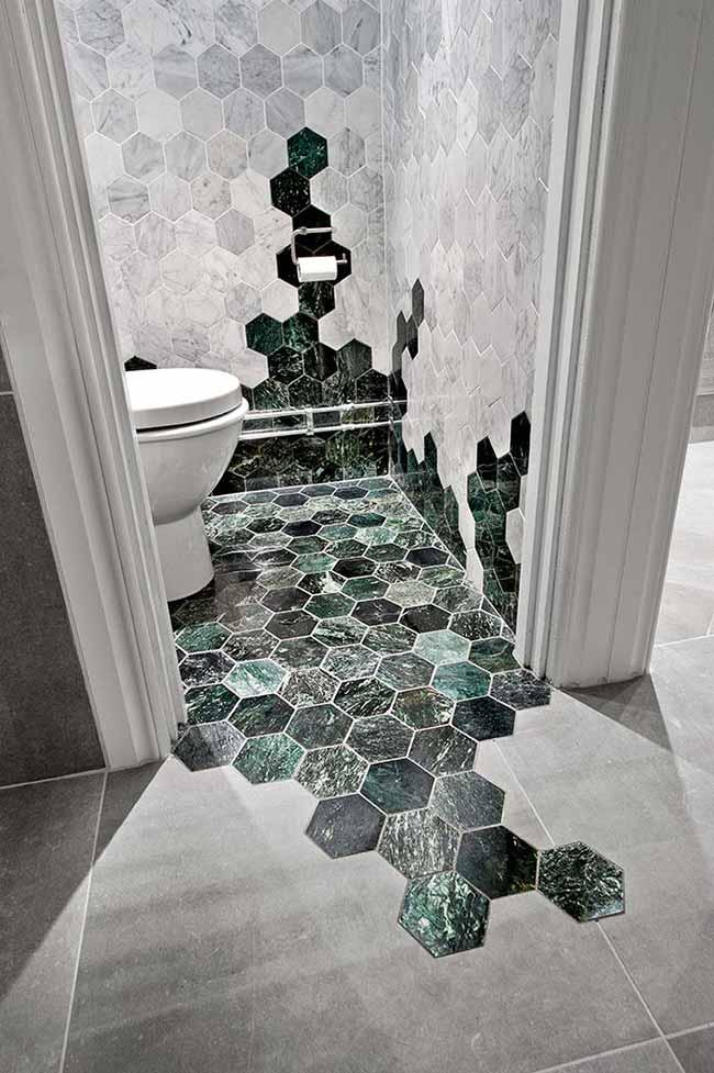 Hexagons of green marble and white marble decorate this bathroom